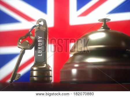3D illustration. Luxury hotel key and vintage golden bell of the United Kingdom on the wooden table of the lobby service.