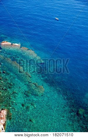 aerial view of a sailing boat in a bay