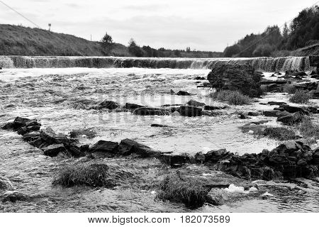 Small waterfall on Tosna River in Leningrad Region Russia. Black and white.