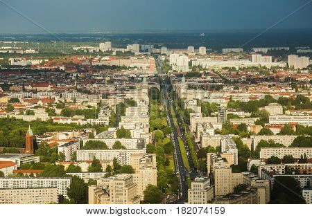 Travel to Germany. View of the houses and streets of Berlin with a bird's-eye view. Overcast sky. Light from the sun on the houses. Residential houses. Megapolis. European city. The capital of Germany. The capital of country