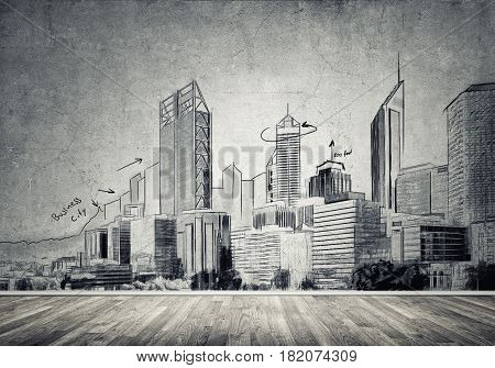 Silhouette of modern city landscape drawn on concrete wall