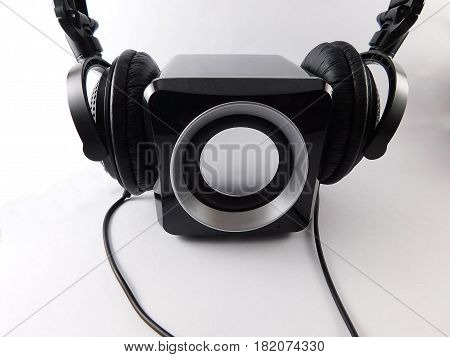 Center speaker with headphones expressing loudness music