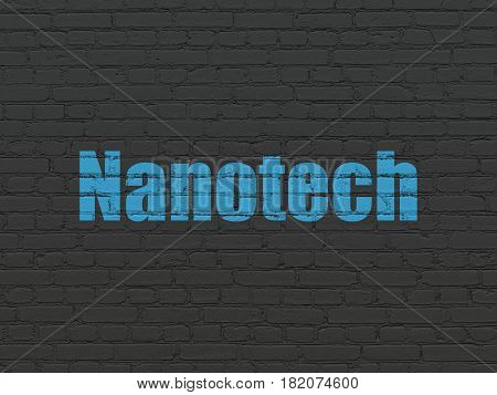 Science concept: Painted blue text Nanotech on Black Brick wall background