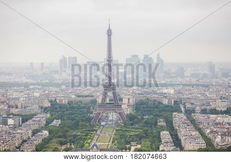 View of the streets of Paris from the heights. Travel through Europe. Attractions in France. Cloudy Paris. Clouds in the sky. Eiffel Tower. High tower in the city. Gray iron tower