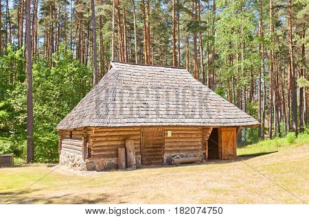 RIGA LATVIA - JUNE 13 2016: Stable (circa 19th c.) of Madari spinning wheelmaker homestead of Vidzeme ethnic group. Exhibited in Ethnographic Open-Air Museum of Latvia since 1975