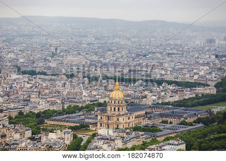 View of the streets of Paris from the heights. Travel through Europe. Attractions in France. Cloudy Paris. Clouds in the sky. Beautiful view at the Pont Alexandre III and Les Invalides in Paris. Aerial view. Aerial view concept