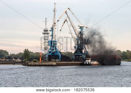 Maritime transportation industry. Coal transshipment to container ships.