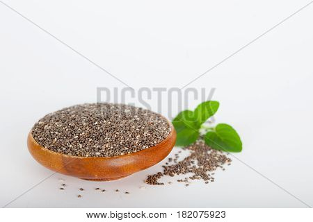 Healthy chia seeds (lat. Salvia hispanica) in wooden bowl. Vegan diet concept