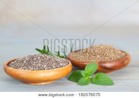 Healthy Chia seeds in wooden bowls. Grained and grinded chia seed.