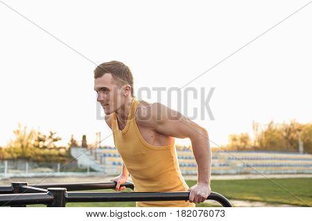 Man Do Workout At Stadium Area With Sunshine Background