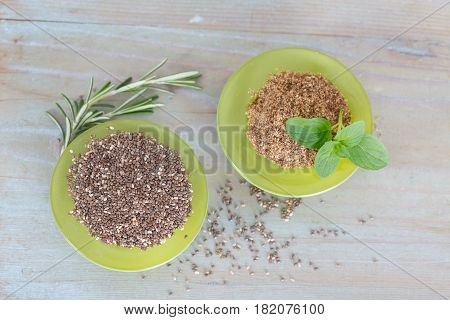 Chia seeds (Salvia hispanica) in green bowls. Superfood  rich in omega-3 fatty acids, essential for good health. Healthy eating, vegan diet concept.