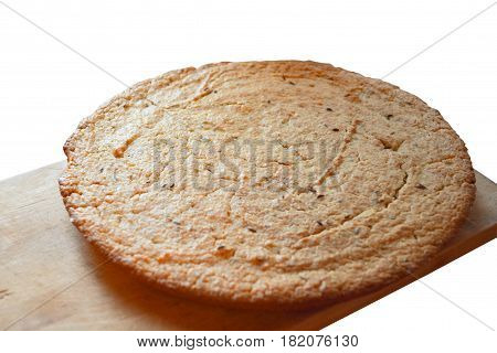 Flat bread with caraway seeds on a wooden board