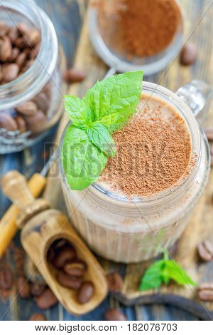 Coffee Smoothie And Mint Leaves In A Glass Jar.