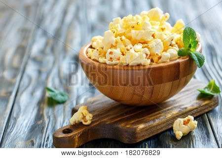 Popcorn With Salt In A Wooden Bowl.