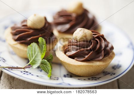 closeup of chocolate or praline tarts or cakes