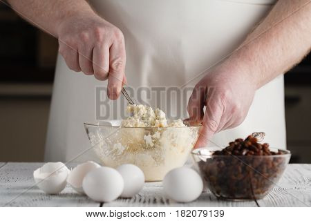 chef preparing food on white wooden table