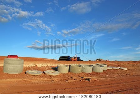 Concrete pipes on a road construction site
