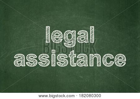Law concept: text Legal Assistance on Green chalkboard background