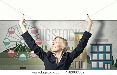 Blond businesswoman lifting white blank banner above head. Place your text