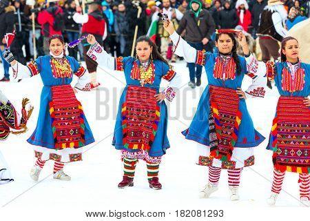 Razlog, Bulgaria - January 14, 2017: Ladies dancing in balkan traditional clothing at the festival