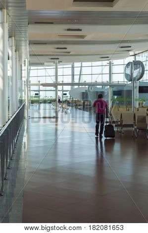 Madrid Spain: 24th July 2016: Passenger waiting for his fly. The Madrid-Barajas Airport is Spain's largest and busiest airport characterised by a floating roof propped by an internal coloured structure.