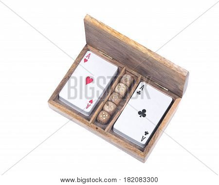 Playing poker cards and dice in wooden box isolated on white background