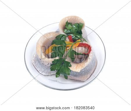 Matjes herring fillets in oil with parsley on clear plate isolated on white background