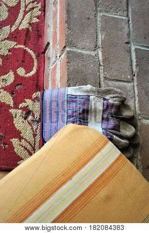 DIY items, rug, gloves, brick and color swatch