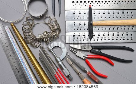 Home made jewelry tools and workplace background texture
