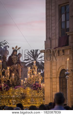 Brotherhood of Jesus corsage making station of penitence in front at the town hall Linares Jaen province Andalusia Spain