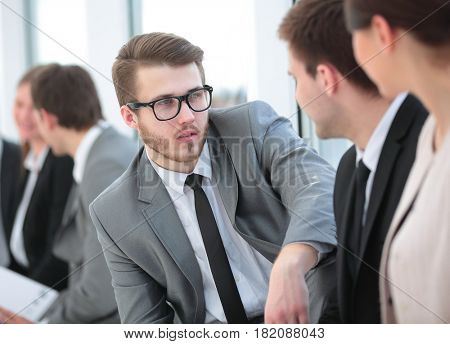 Business and office concept - smiling business team sitting in a