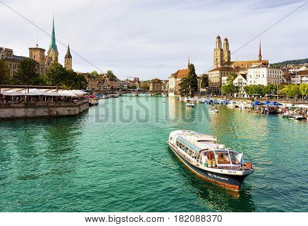 Grossmunster Saint Peter And Fraumunster And Boats At Limmat Zurich