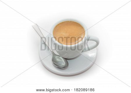 Cup of fresh brewed espresso with a spoon isolated on white background