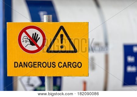 Signs warn of job security. Sign 'dangerous cargo'.