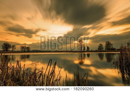 Magnificent long exposure lake sunset in summer