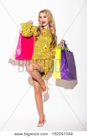 Portrait Of Young Woman Holding Several Shoppingbag