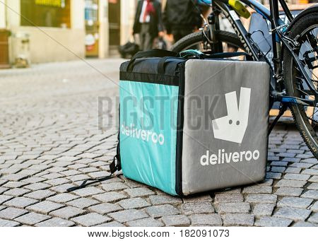 STRASBOURG FRANCE - APR 3 2017: Detail of Deliveroo bike and cargo box parked in city. Deliveroo is a British online food delivery company