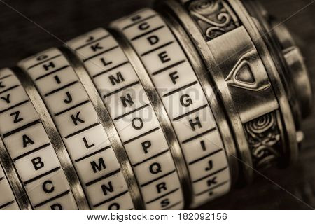 blog word as a password to combination puzzle box with rings of letters, sepia toned
