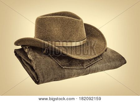 felt wool cowboy hat and  folded jeans, retro sepia toned