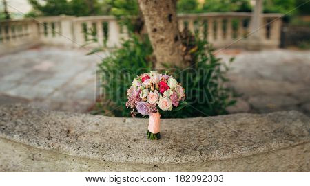 Wedding bouquet on a stone background. Wedding in Montenegro