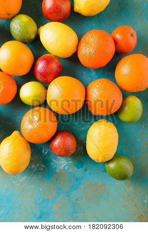 Sicilian oranges turquoise abstract background. Sicilian orange. Citrus fruits. Mixed festive colorful tropical and citrus fruit. Healthy eating photo concept. Copyspace