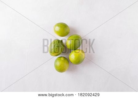 Lime on a light background. lemons Sicilian orange. Citrus fruits. Mixed festive colorful tropical and citrus fruit. Healthy eating photo concept. Copyspace