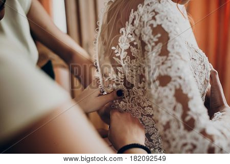Bridesmaids Helping Stylish Happy Bride Fit In Dress, Back View At Window, Rustic Wedding Morning Pr
