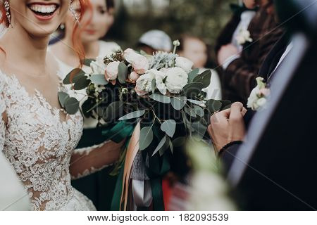 Stylish Happy Bride Holding Modern Bouquet And Smiling. Emotional Moment. Rustic Wedding Morning. Sp