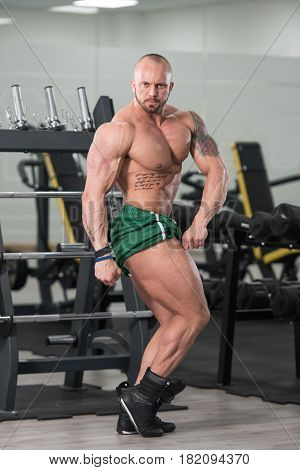Man Showing His Well Trained Body In Gym