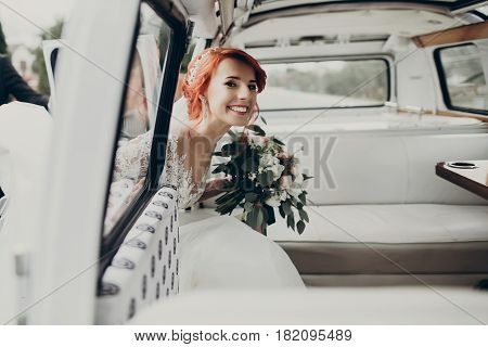 Stylish Happy Bride Getting Inside Of Retro Bus And Smiling. Emotional Moment, Space For Text. Luxur