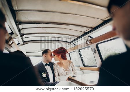 Stylish Happy Bride And Groom Embracing,gently Hugging In Retro Car And Smiling. Emotional Moment, S