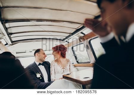 Stylish Happy Bride And Groom Embracing, Smiling Having Fun In Retro Car. Funny Emotional Moment, Sp
