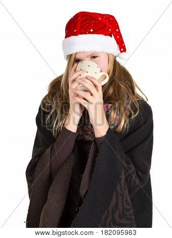 Young girl with black cape and red winter cap holding cup isolated on white background