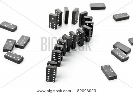 Domino game stones forming question mark - risk challenge or uncertainty concept